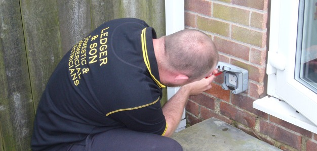 Ruri installing an outdoor socket